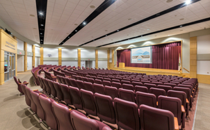 Vines Center auditorium with seats, stage and projector